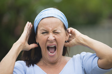 Portrait mature woman yawning stretching