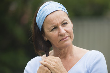 Sad lonely mature woman in grief and depression