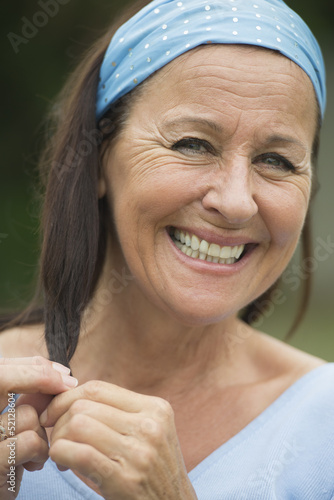 Happy relaxed attractive senior woman