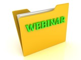 WEBINAR bright green letters on a yellow folder with papers