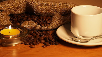 romantic background with candles, a cup of coffee