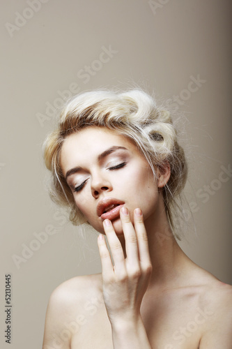 Purity. Sensual Blond Female with Closed Eyes touching her Face