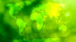 World map, continents in green bokeh background.