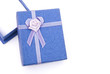 blue gift box with ribbon and flower on white with copy space