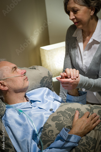 Old woman taking care of sick husband