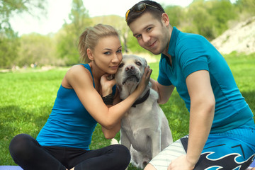 Young couple with a dog in the park