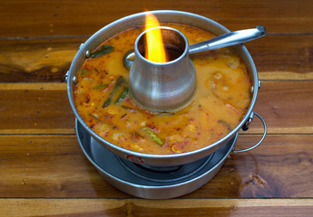 Tom Yum seafood soup in hot pot ,Thai food favorite on the wood