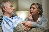 Senior patient at hospital with worried wife