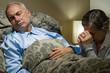 Senior woman praying for her sick husband