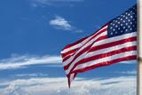 Usa American flag stars and stripes on the blue sky background