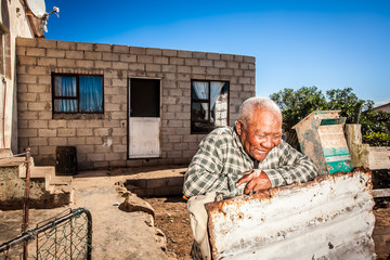 Man in front of his township house
