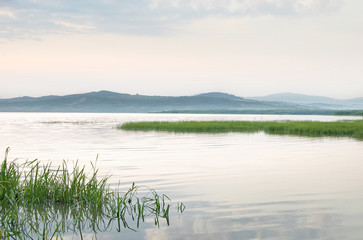 relaxing minimal landscape with lake and hills