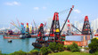 Container ship under cranes at Hong Kong port.