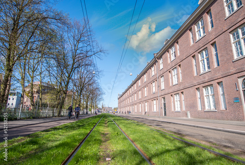 Amsterdam Buildings and tram railway in spring