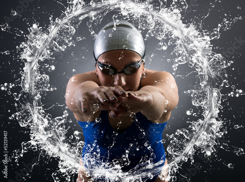 Foto op Canvas Zeilen swimmer jumps into the water.