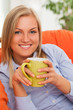 Young blond woman with mug