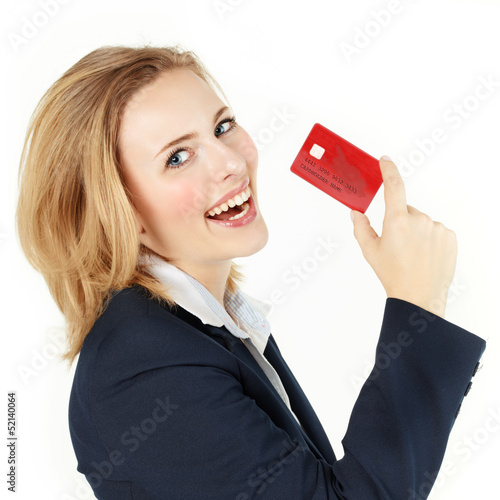 Pretty blonde woman proudly presents her credit card