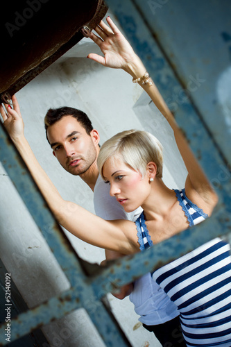 urban couple, man and woman posing