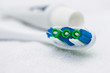 Closeup image of toothbrush and tube