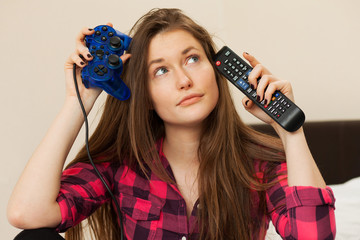 Young woman with joystick and TV console