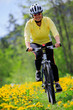 Bike riding - woman on bike, active adult concept