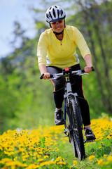 Bike riding - woman on bike, active adult concept