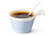 Plastic coffee mug with a spoon