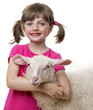 happy little girl with a sheep isolated on a white background