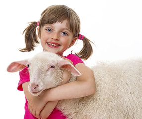 happy little girl with sheep