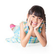 Portrait of a cute happy little asian girl laying on floor