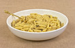 Cooked penne pasta with mushrooms in bowl
