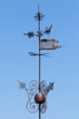Vintage weather vane above blue sky in Tallinn