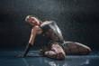 Wet woman in underwear dancing in a studio