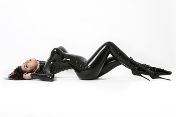 Sexy brunette in black latex. High heels
