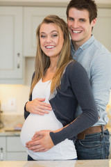 Man embracing pregnant partner
