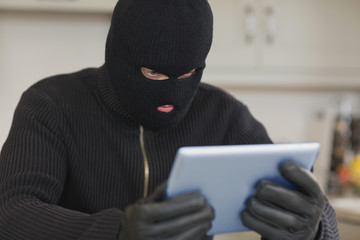 Burglar holding tablet pc