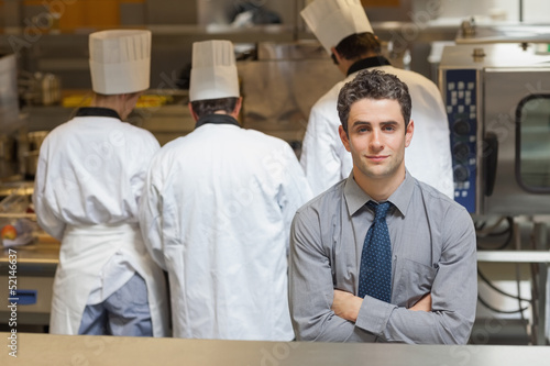 Waiter standing in the kitchen