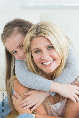 Daughter hugging her mother from behind