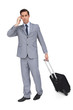 Serious businessman on the phone while holding his suitcase