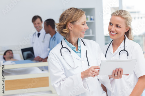 Smiling doctors talking to each other