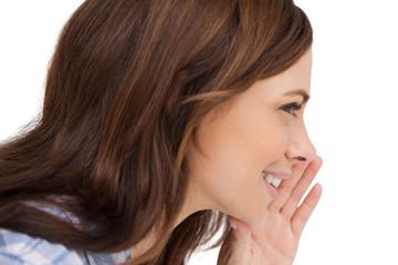 Brunette woman whispering a secret