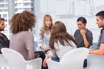 Woman crying during group therapy session