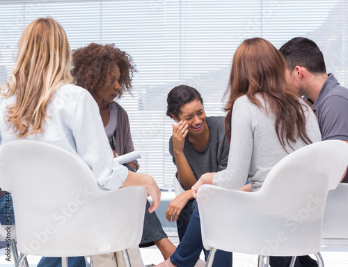 Therapist taking notes while patient crying