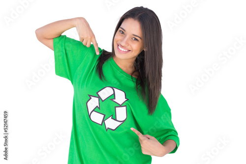 Enivromental activist pointing to the symbol on her tshirt