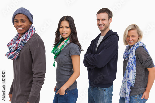 Stylish young people in a row smiling