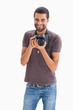 Cheerful man with camera around his neck