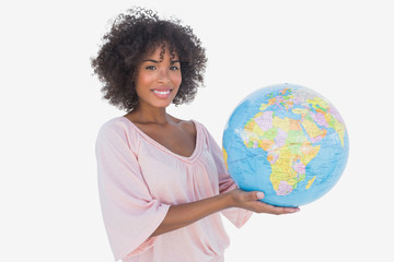 Happy woman holding globe