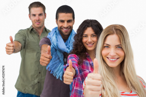 Friends giving thumbs up in a row