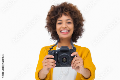 Happy girl holding a camera