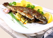 Grilled whole trout with potato, lemon and garlic